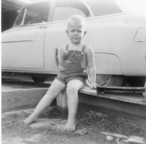 David Parrott playing in front of the family car in 1955.