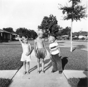 Robert Parrott playing with neighborhood friends on the sidewalk in front of the Parrott's house in 1955.