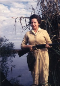 Grace with her shotgun on a hunting trip in 1958.